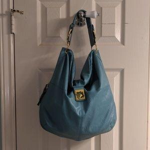 Mark (Avon) Teal Handbag with Gold Accents